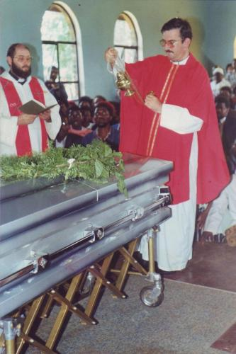 Fr John Finn msc incenses the coffin